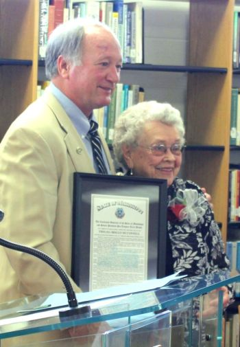 East Mississippi Community College President Dr. Rick Young presents Thelma Briggs McConnell with a framed proclamation announcing Thelma Briggs McConnell Day.
