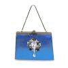 Brooch on a handbag